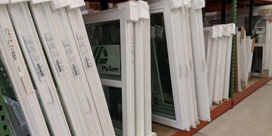 PLY GEM 1500 series single hung windows. In stock Adirondack molding.