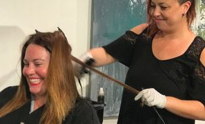 Vanessa Mills preforming a Keratin Treatment