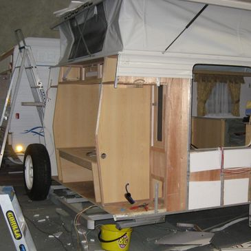 caravan repair with rear and partial side walls removed