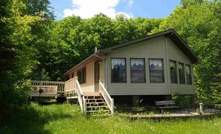Lake Home on Wooded Acreage! 75 feet of lake front, nice lawn and pretty views,