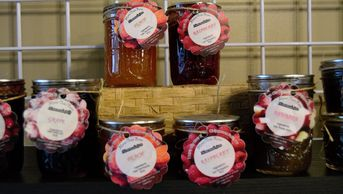 A variety of jams and jellies made from farm produce.