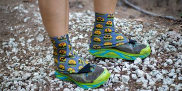 Emoji Hamburger Gaiters on Gray being worn on trails to keep debris from getting into the shoes.