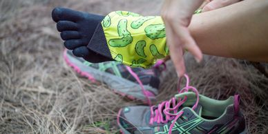 Trail runner putting on a gaiter
