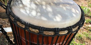 a drum in the grass, used for drumbeat therapy