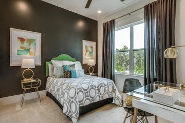 Builder selections and model home with black walls with green headboard and white bedding