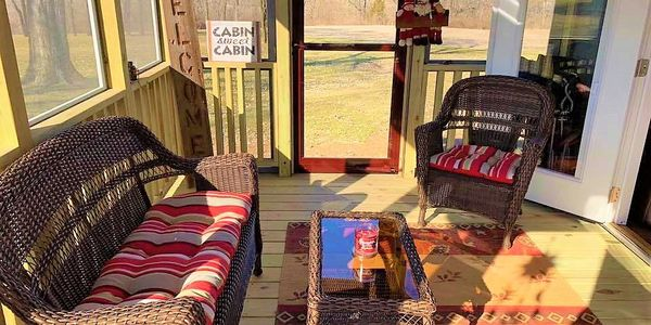 Open airy screened porches extend the feel, flow, and comfort to your tiny rustic cabin.