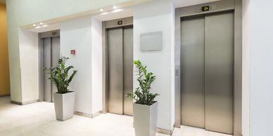 Bank of elevators in an apartment.