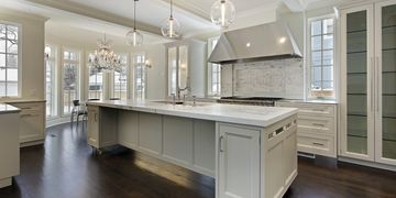 Open concept Kitchen with tons of storage space, quartz countertops, and  beautiful lighting.