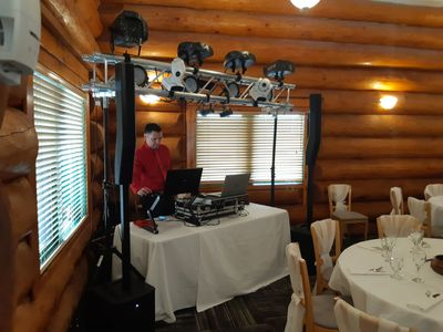 Dale with his small DJ booth, mixing equipment,speakers  and lights at a wedding.