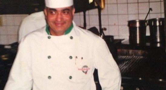 David Koonar, Owner & Executive Chef, cooking in the kitchen