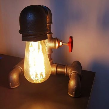 A cool lamp shade made from plumbing pipes