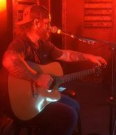Country singer Allen Higgs with guitar. Live streaming.