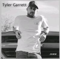 Country singer Tyler Garrett on truck.