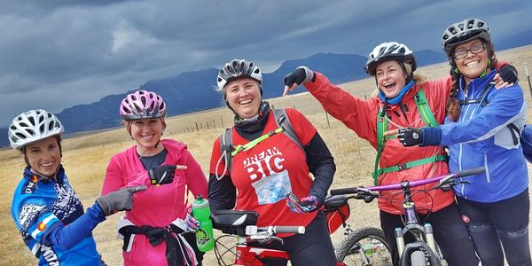 Dream big team spirit mountain biking Colorado facing struggles support fun friendship bicycle trips