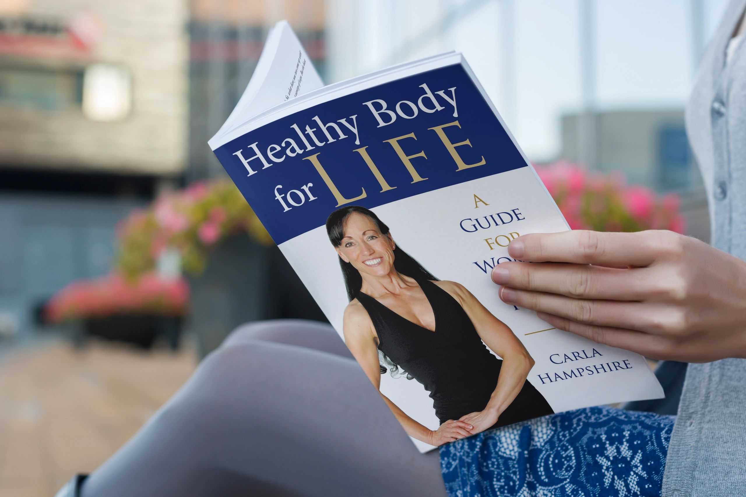 woman holding a health book for women over 40