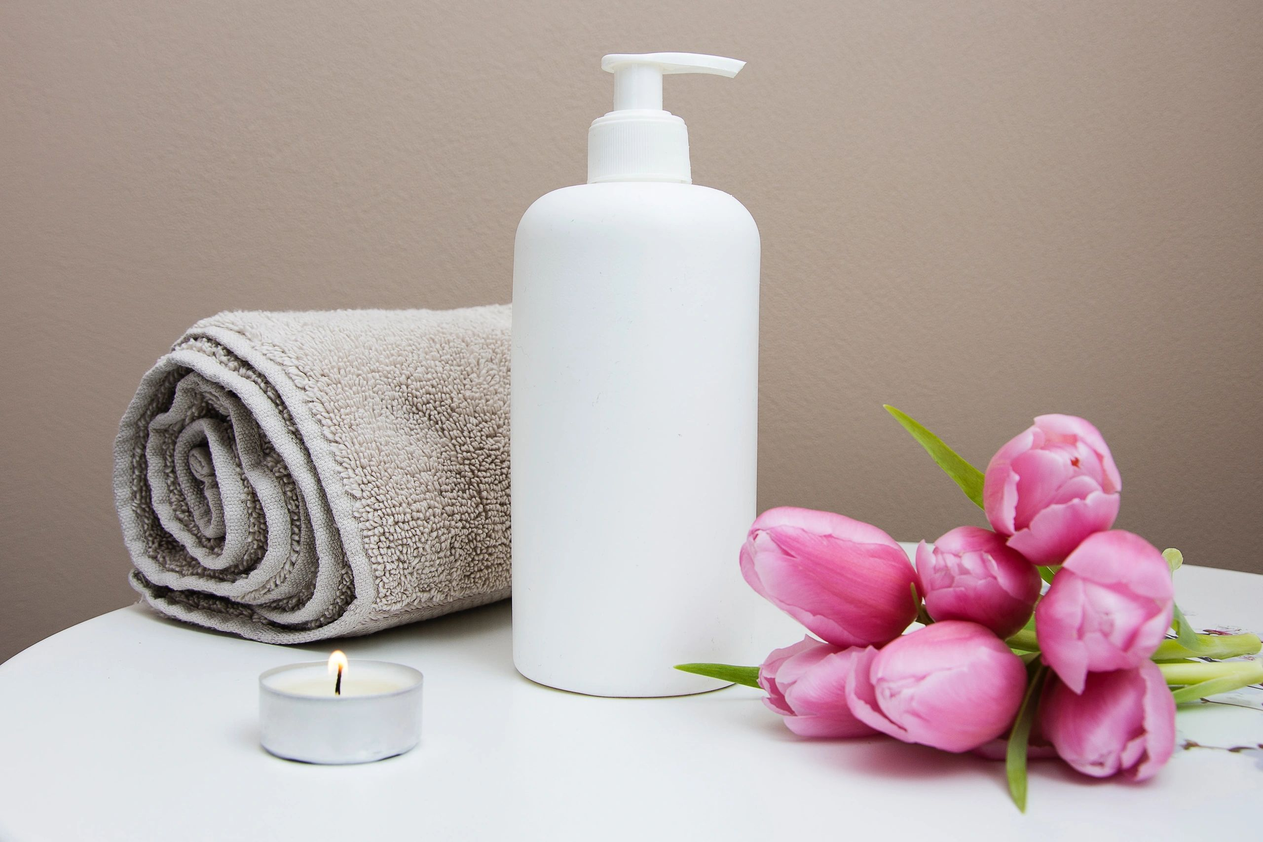 Donna Lynn Highlights and Skincare image of lotion and towel on table