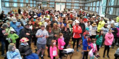 People cheer for a horse hoping to win the 50/50 charity raffle at the Ironstone Derby 5K