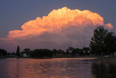 Cloud over water with pink haze