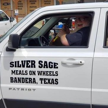 Silver Sage Senior Center Meals On Wheels during a Bandera parade.
