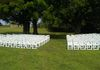 White Resin Chairs set up for a wedding ceremony, pic 1