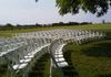 White Resin Chairs set up for a wedding ceremony, pic 2.