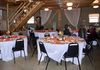 Tables and chairs set up in the Barn for group meals.  There is a bathroom on this floor.