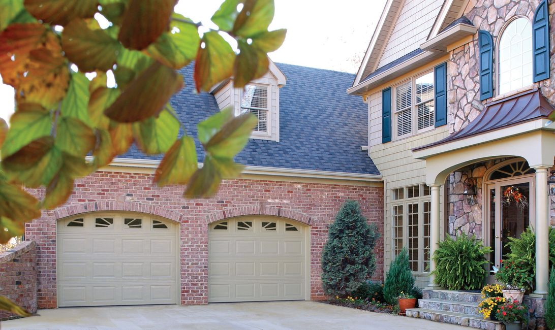 Traditional short panel garage door with windows.