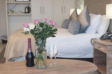 Romantic Getaway theme at Point Hotel and Spa from its Suits room with a bottle of Wine and Roses