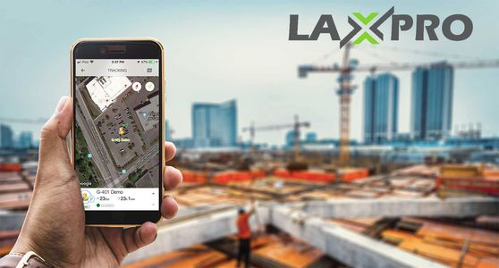 Someone holding an Android smartphone with LAXPRO on the screen. Construction crane in background
