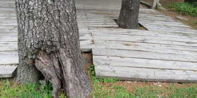 Deck with earth to wood contact that promotes water penetration and water damage Houston Inspector