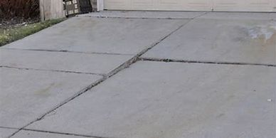 Inspector found cracked and lifted sections of concrete driveway in home inspection Houston best fee