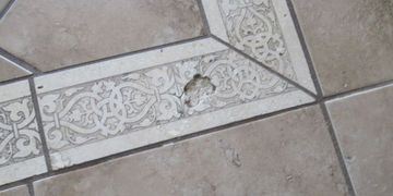 Cracked and damaged floor tiles at home inspection Houston Top rated inspectors Houston quote cost
