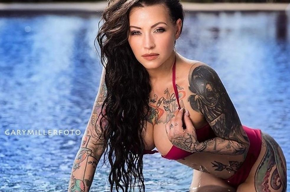 hot girl in a pool. Girls with tattoo.