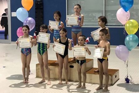 Young athletes show off certificates of achievement