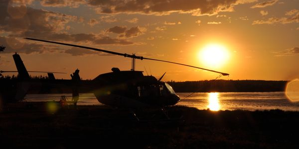 Bell 206 helicopter sunset