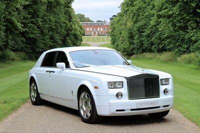 Rolls Royce car in front of building