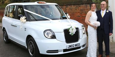 father of the bride and daughter next to wedding Taxi cab