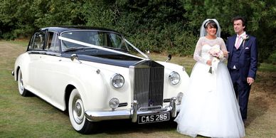 bride + father standing next to Rolls Royce