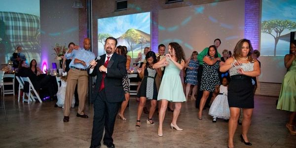 DJ George teaching a line dance during a wedding reception at Zen in Greenville, SC.