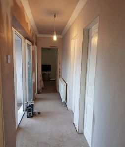 New radiator, electrical alterations, plasterwork, skirting & architrave