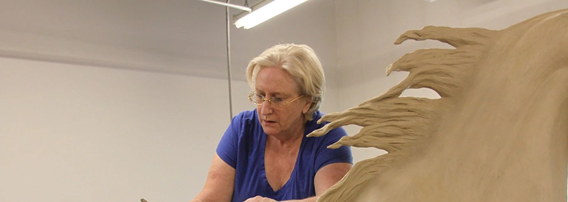 Anne hard at work on a life size equine bronze sculpture commission.
