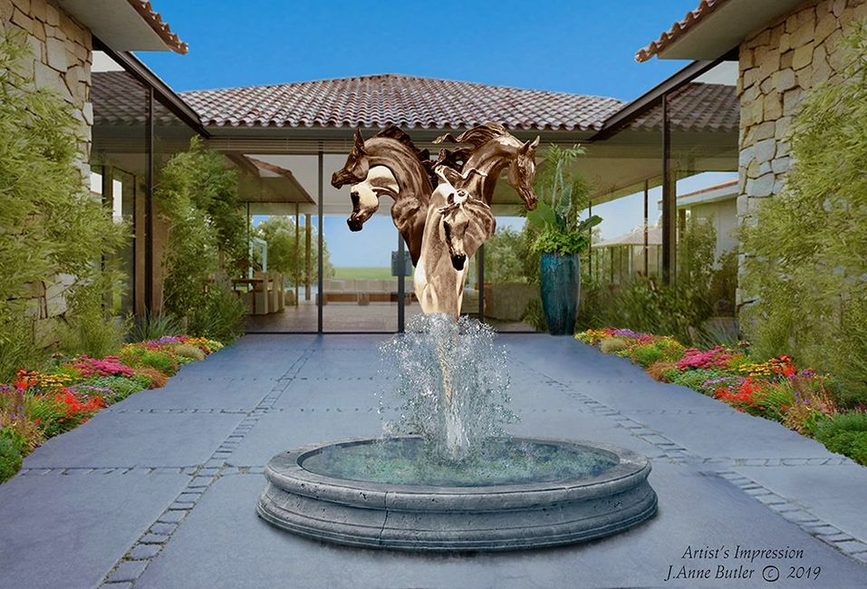 Fountain in bronze highlighting four full sized horse heads.  Figurative bronze sculpture.