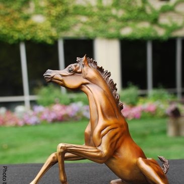 Rise and Shine bronze greets you and brings a smile to you face.  Fine Art is there to enjoy!