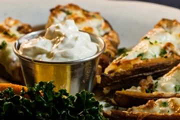 Appetizer potato skins with sour cream.