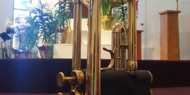 Zack Richards Music's Flip Oakes Wild Thing Trumpet in front of the First Church altar on Easter