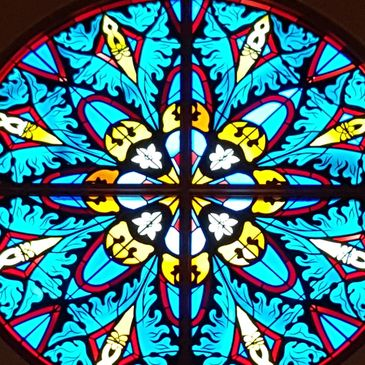 Close-up view of the stained glass window at First Lutheran Church