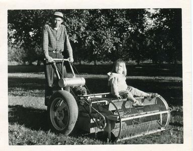 """Dave"", pictured here with daughter Rose, who is sitting on an early harvesting picker."