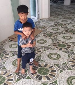 Two of more than 30 orphan children who live at Mai Am Thi An orphanage.