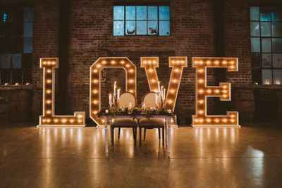 Marquee LOVE Sign wedding rentals. Sweetheart table set up at the Old Sugar Mill in Clarksburg, CA