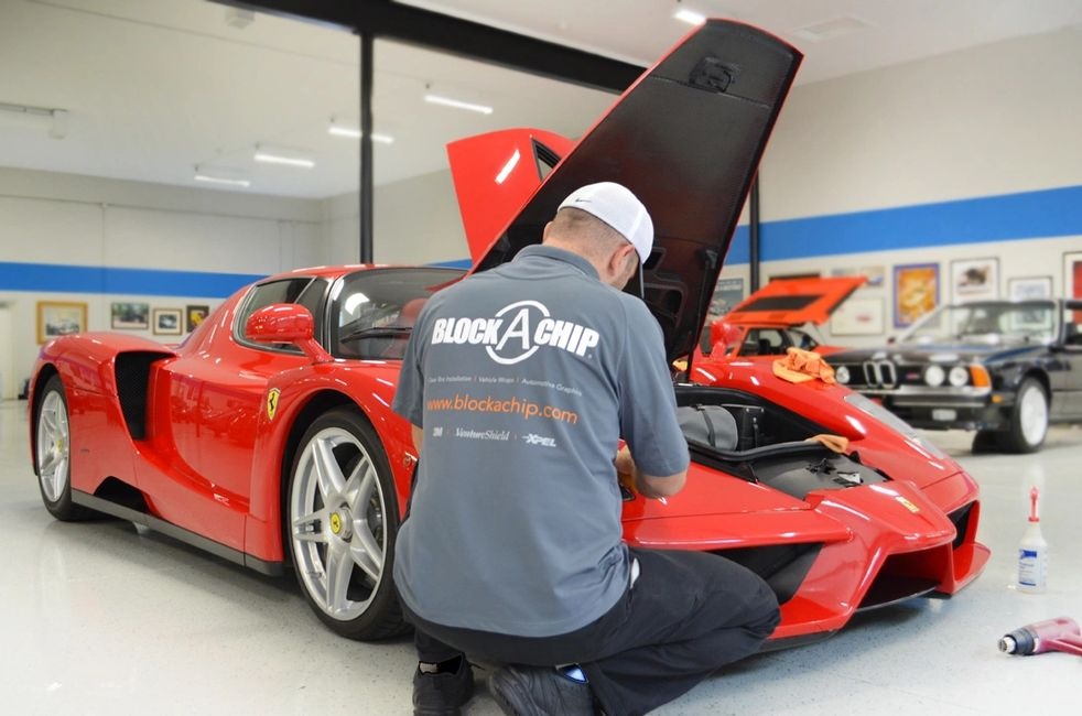 Paint Protection Film (clear bra) XPEL Ultimate in the process of being installed on the iconic Enzo